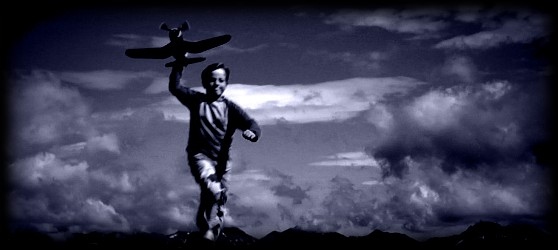 Photo of boy with toy plane